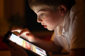 A-ten-year-old-boy-uses-an-Apple-Ipad-tablet-computer