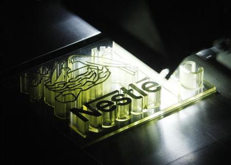 A Nestle logo is printed by a 3D printer during a display for the inauguration of the system technology centre for the design, development and deployment of their products in Orbe